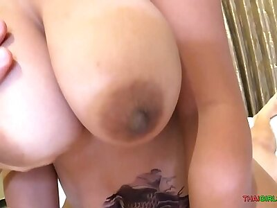 Big tit Asian MILF rides white blarney